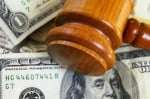 closeup of a gavel on cash, from above